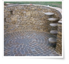 Dry stone wall and circular paving design